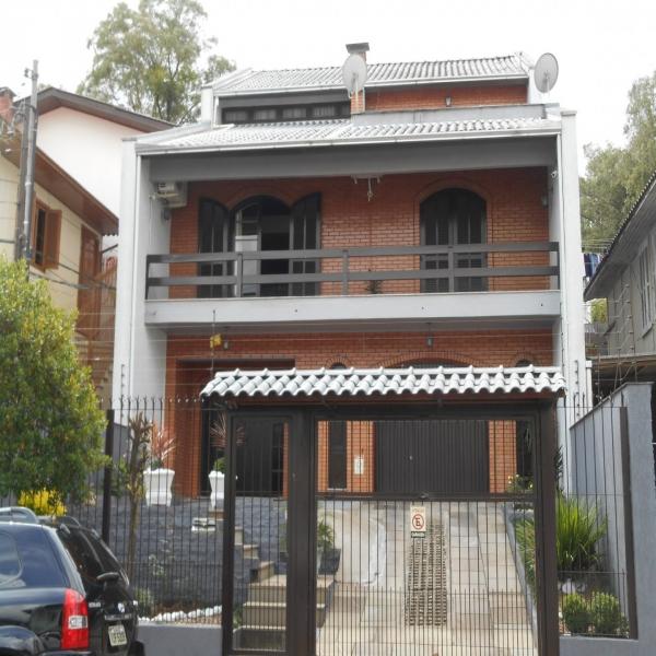 Casa Residencial 4 dormitórios em Caxias do Sul no bairro RIO BRANCO